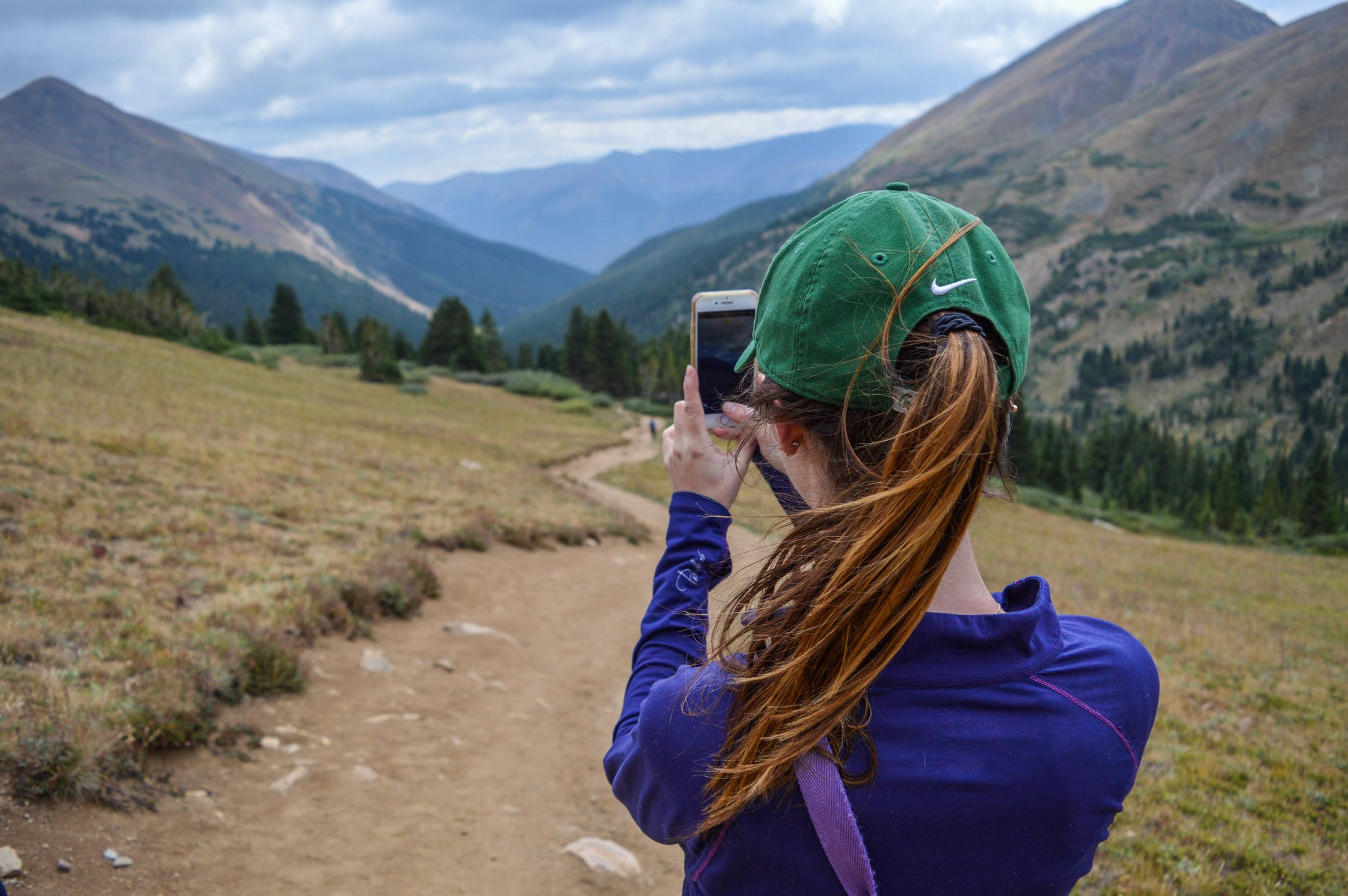 woman taking photo of mountain
