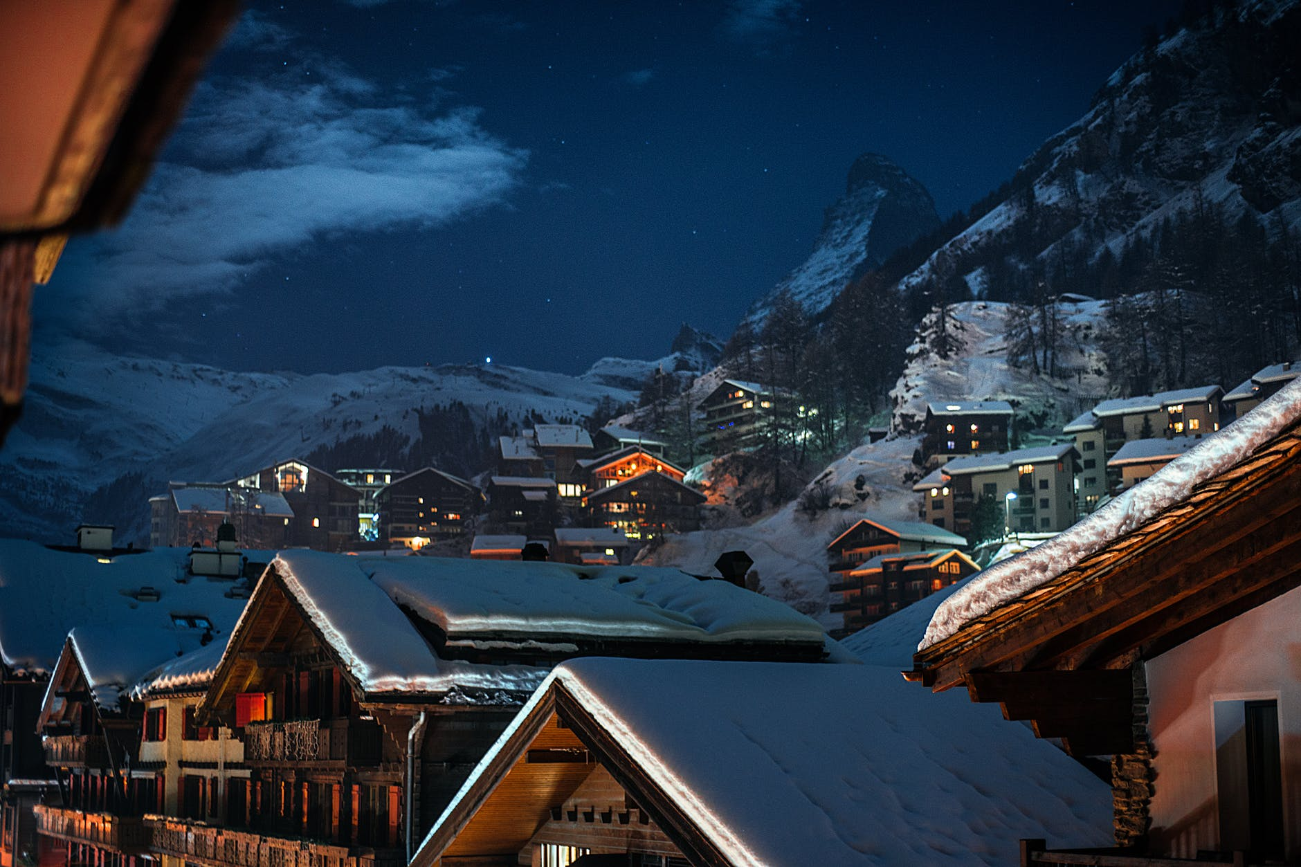 village with residential houses on snowy mounts