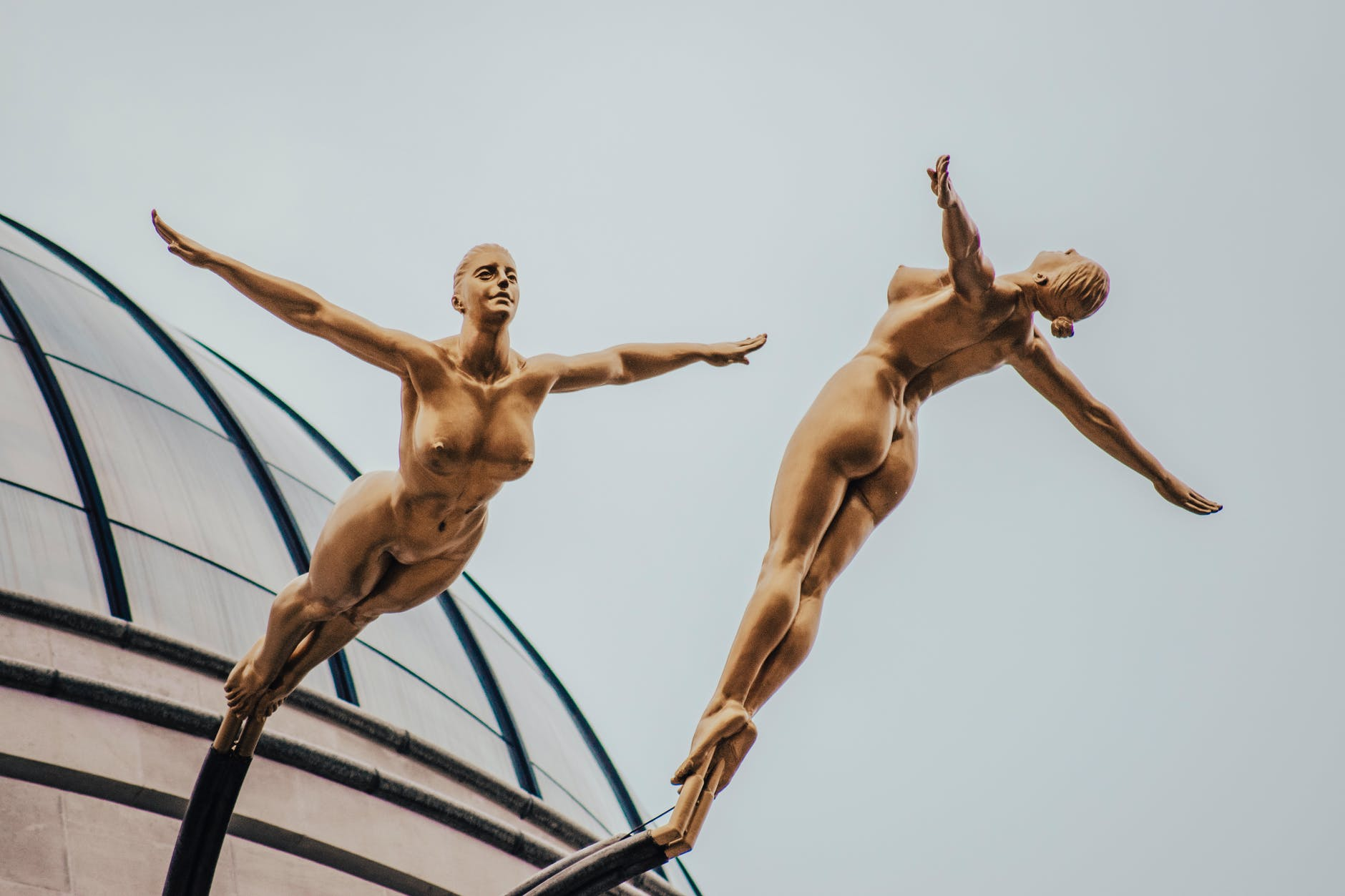 two gold nude woman statue